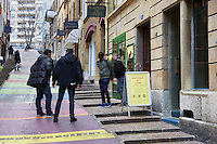 """Switzerland. The Republic and Canton of Neuchâtel. Neuchâtel. Downtown. Narcotics squad. """"Narko"""" operation. Two police officers on duty (both in plain-clothes) arrest a drug dealer from Western Africa and his customer. The convict black man is handcuffed because he was caught selling illegal drugs (cocaine) in the streets. Plainclothes law enforcement is a method used by police. The policemen wear plainclothes or """"ordinary clothes"""" instead of a uniform in order to avoid detection or identification as law enforcement agents. Police officers in plainclothes must identify themselves when using their police powers. 1.04.15 © 2015 Didier Ruef"""