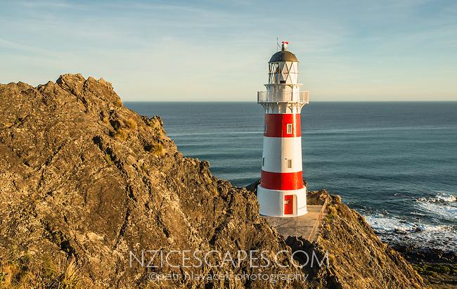 Sunset at Cape Palliser lighthouse, Palliser Bay, Wellington Region, North Island, New Zealand, NZ