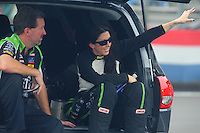 Nov. 10, 2011; Pomona, CA, USA; NHRA funny car driver Alexis DeJoria (right) with a crew member during qualifying at the Auto Club Finals at Auto Club Raceway at Pomona. Mandatory Credit: Mark J. Rebilas-.