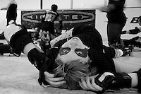 """""""Roadhouse Rhonda"""" of the Oakland Outlaws stretches before the Bay Area Derby Girls' season opener in Oakland, CA...(©Matt McKnight, 2008)"""