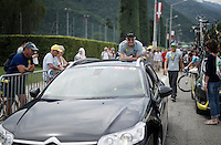 (Team Tinkoff owner) Oleg Tinkov jumps on the back bumper of a passing car at the start for a little 'ride-along'<br /> <br /> Stage 19:  Albertville › Saint-Gervais /Mont Blanc (146km)<br /> 103rd Tour de France 2016