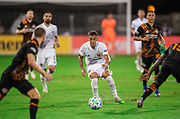LAKE BUENA VISTA, FL - JULY 23: Rolf Feltscher #25 of the LA Galaxy passes the ball during a game between Los Angeles Galaxy and Houston Dynamo at ESPN Wide World of Sports on July 23, 2020 in Lake Buena Vista, Florida.