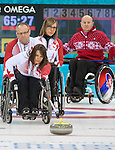 Sochi, RUSSIA - Mar 13 2014 - Sonja Gaudet, Ina Forrest and Dennis Thiessen as Canada takes on Slovakia in round robin play at the 2014 Paralympic Winter Games in Sochi, Russia.  (Photo: Matthew Murnaghan/Canadian Paralympic Committee)