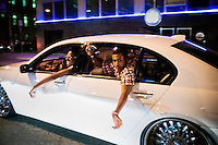 Youngsters cruising in a car through downtown Detroit, Michigan on a Friday night.