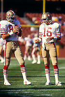 SAN FRANCISCO, CA - Joe Montana and Dwight Clark of the San Francisco 49ers warm up on the sidelines before a game at Candlestick Park in San Francisco, California in 1987.  Photo by Brad Mangin