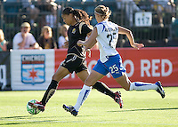 Adriane (left) sprints downfield, chased by Nancy Augustyniak-Goffi. Boston Breakers defeated FC Gold Pride 1-0 at Buck Shaw Stadium in Santa Clara, California on July 19, 2009.