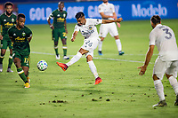 CARSON, CA - OCTOBER 07: Efrain Alvarez #26 of the Los Angeles Galaxy takes a shot on goal during a game between Portland Timbers and Los Angeles Galaxy at Dignity Heath Sports Park on October 07, 2020 in Carson, California.