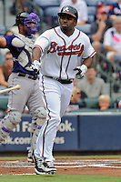 Atlanta Braves center fielder Michael Bourn #24 takes first after being walked during a game against the Colorado Rockies at Turner Field on September 3, 2012 in Atlanta, Georgia. The Braves  defeated the Rockies 6-1. (Tony Farlow/Four Seam Images).