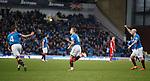 Dean Shiels runs away banging the Rangers crest on his shirt after scoring