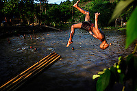 Novice monks from the Myazeda Man Oo Monastery, where they produce promotional material and literature for the Buddhist nationalist 969 movement, play in a lake in the grounds of the monastery in Mawlamyine, Mon State. /Felix Features