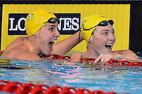 Bronte Campbell and Cate Campbell of AUS react at the conclusion of 100 meter freestyle final during Commonwealth Games Swimming, Monday, July 28, 2014 in Glasgow, United Kingdom. (Mo Khursheed/TFV Media via AP Images)