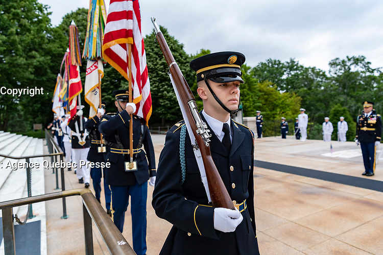 The Joint Service Color Guard march out as part of the National Memorial Day Observance at Arlington National Cemetery, Arlington, Virginia, May 25, 2020. This was the 152nd Memorial Day wreath-laying and observance ceremony at Arlington National Cemetery. (U.S. Army photo by Elizabeth Fraser / Arlington National Cemetery / released)