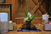 MAY 15, 2014 - KOJIMA, KURASHIKI, JAPAN: Flower on a Denim cloth at a Udon nudle restaurant .  (Photograph / Ko Sasaki)