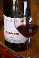 Cuvee Schistes. Domaine Coume del Mas. Banyuls-sur-Mer. Roussillon. France. Europe. Bottle. Wine glass.
