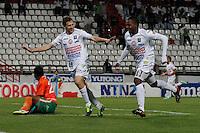 MANIZALES, COLOMBIA, 29-08-2013.  Patricio Pérez (I) y José Heriberto Izquierdo (D) de Once Caldas celebran un gol en contra del Envigado durante partido válido por la séptima fecha de la Liga Postobón II 2013 jugado en el estadio Palogrande de la ciudad de manizales./ Once Caldas players Patricio Pérez (L) y Jose Heriberto Izquierdo (R)  celebrate a goal against Envigado player xxx during a match valid for the  seventh date of the Postobon League II 2013 at Palogrande stadium in Manizales city. Photo: VizzorImage/ Yonboni/STR