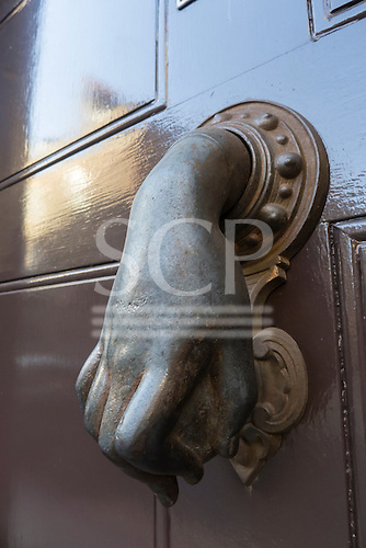 Spitalfields, London. Front door knocker in the form of a hand, a common design in this area. Known as the Hand of Fatima, it is believed to original in Muslim countries. This one is a reproduction one.