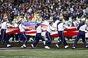SEATTLE, WA - September 07:  Washington Band members cary the United States flag onto the field before the college football game between the Washington Huskies and the California Bears on September 07, 2019 at Husky Stadium in Seattle, WA. Jesse Beals / www.Olympicphotogroup.com