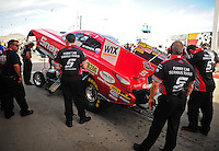 Mar. 30, 2012; Las Vegas, NV, USA: NHRA crew members for funny car driver Cruz Pedregon during qualifying for the Summitracing.com Nationals at The Strip in Las Vegas. Mandatory Credit: Mark J. Rebilas-