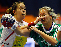 SERBIA, Novi Sad: Hungary's Piroska Szamoransky (R) vies with Spain's Begona Fernandez (L) during their Women's Handball World Championship 2013 eight-final match Hungary vs Spain on December 16, 2013 in Novi Sad.  AFP PHOTO / PEDJA MILOSAVLJEVIC