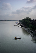 A boat sits on the hoogly river in the Howrah area of Kolkata, India, on Friday, May 26, 2017. Photographer: Sanjit Das