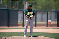 Oakland Athletics relief pitcher Jorge Martinez (61) prepares to deliver a pitch during an Extended Spring Training game against the San Francisco Giants Orange at the Lew Wolff Training Complex on May 29, 2018 in Mesa, Arizona. (Zachary Lucy/Four Seam Images)