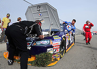 Feb 21, 2009; Fontana, CA, USA; NASCAR Sprint Cup Series driver Reed Sorenson climbs from his car after crashing during practice for the Auto Club 500 at Auto Club Speedway. Mandatory Credit: Mark J. Rebilas-
