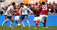 Calcio, Serie A: Roma-Genoa. Roma, stadio Olimpico, 12 gennaio 2014.<br /> From left, Genoa forward Emanuele Calaio', and midfielder Thomas Manfredini are challenged by AS Roma midfielder Radja Nainggolan, of Belgium, and defender Nicolas Burdisso, of Argentina, right, during the Italian Serie A football match between AS Roma and Genoa, at Rome's Olympic stadium, 12 January 2014. AS Roma won 4-0.<br /> UPDATE IMAGES PRESS/Isabella Bonotto