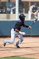 Colorado Rockies minor league infielder Juan Ciriaco #1 during an instructional league game against the San Francisco Giants at the Salt River Flats Complex on October 4, 2012 in Scottsdale, Arizona.  (Mike Janes/Four Seam Images)