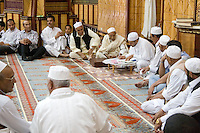 """Tripoli, Libya.  Muslim Wedding Celebrations.  Preparing Marriage Contract for Signing; Sheikh (""""Ma'doun"""") Officiates, while male family and friends witness."""