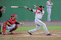 Third baseman Francisco Lindor (12) of the Carolina Mudcats bats in a game against the Potomac Nationals on Friday, June 21, 2013, at G. Richard Pfitzner Stadium in Woodbridge, Virginia. Lindor was taken by the Cleveland Indians in the first round of the 2011 First-Year Player Draft and is the Indians' No. 1 prospect. Potomac won, 5-1.  The Nats catcher is Cole Leonida. (Tom Priddy/Four Seam Images)