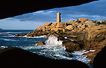 France, Brittany, near Ploumanac`h: Lighthouse above stormy sea on the Pink Granite Coast