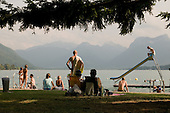 Bathers on the public beach of Talloires, a holiday resort on Lake Annecy in the French Alps