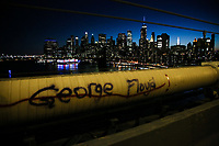 NEW YORK, NEW YORK - MAY 31: George Floyd's name on the Manhattan Bridge on May 31, 2020 in New York. Protests spread across the country in at least 30 cities in the United States. USA For the death of unarmed black man George Floyd at the hands of a police officer, this is the latest death in a series of police deaths of black Americans (Photo by Pablo Monsalve / VIEWpress via Getty Images)