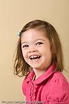closeup headshot portrait of girl age 3 vertical