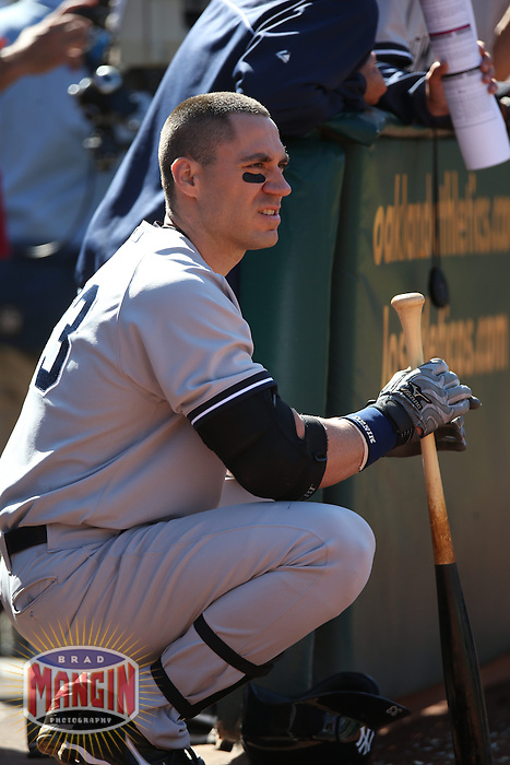OAKLAND, CA - JUNE 13:  Travis Hafner #33 of the New York Yankees waits for his next at bat against the Oakland Athletics during the game at O.co Coliseum on Thursday June 13, 2013 in Oakland, California. Photo by Brad Mangin
