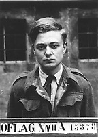 BNPS.co.uk (01202 558833)<br /> Pic: IronCrossMagazine/BNPS<br /> <br /> Pictured: Lt John Hamilton-Baillie, a repeated escaper.<br /> <br /> The comical escape attempts made by British officers from a German prisoner of war camp called Castle Tittmoning have been revealed 80 years later.<br /> <br /> The desperate efforts to break out of the little known but rude sounding camp included three men who hid inside a cramped fireplace for eight days before being found by guards covered in soot. <br /> <br /> Other officers hid under piles of rubbish on a horse-drawn cart and allowed themselves to be driven out of the fortress before they were discovered.<br /> <br /> The men expertly made German uniforms out of blankets and brazenly walked out of the camp disguised as guards before being rumbled.