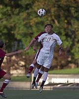 Harvard University defender Eric Slingerland (26) and Boston College forward Charlie Rugg (17) battle for head ball. Boston College defeated Harvard University, 2-0, at Newton Campus Field, October 11, 2011.