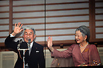 December 23, 2012, Tokyo, Japan - Emperor Akihito, accompanied by Empress Michiko, waves to a throng of well-wishers from behind the bullet-proof glass panel of the Imperial Palace balcony in Tokyo on Sunday, December 23, 2012. More than 20,000 well-wishers turned out to the palace, celebrating the 79th birthday of the monarch, who said in his statement that he's concerned about the country's aging population. (Photo by AFLO) UUK -mis-