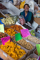 Peru, Cusco, San Pedro Market.  Woman Selling Dried Fruits and Nuts.