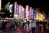 Visitors walk through the popular Nanjing Road shopping street.<br /> <br /> To license this image, please contact the National Geographic Creative Collection:<br /> <br /> Image ID: 2169208 <br />  <br /> Email: natgeocreative@ngs.org<br /> <br /> Telephone: 202 857 7537 / Toll Free 800 434 2244<br /> <br /> National Geographic Creative<br /> 1145 17th St NW, Washington DC 20036