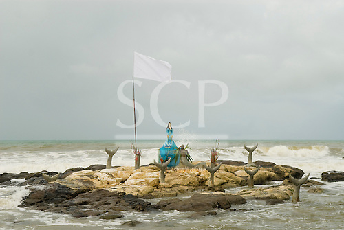 Olivenca, Bahia State, Brazil. Shrine to the Candomble goddess Iemanja on a rocky islet in the sea.