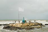 Olivenca, Bahia State, Brazil. Shrine to the Candomble goddess Iemanja on a rocky islet in the sea.