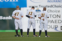 (L-R) Colin Curtis #47, Seth Fortenberry #13 and James Cooper #31 of the Trenton Thunder during the National Anthem at Waterfront Park May 12, 2009 in Trenton, New Jersey. (Photo by Brian Westerholt / Four Seam Images)
