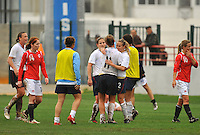 Heather Mitts (#2), emphatically hugs Lauren Cheney (#11). The USA defeated Norway 2-1 at Olhao Stadium on February 26, 2010 at the Algarve Cup.