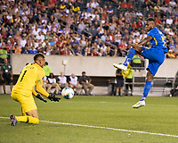 PHILADELPHIA, PA - JUNE 30: Leandro Bacuna #10 shoots the ball with Zack Steffen #1 saving the ball during a game between Curaçao and USMNT at Lincoln Financial Field on June 30, 2019 in Philadelphia, Pennsylvania.