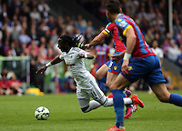Pictured L-R: Marvin Emnes of Swansea is brought down by Mile Jedinak of Crystal Palace <br /> Re: Premier League match between Crystal Palace and Swansea City at Selhurst Park on Sunday 24 May 2015 in London, England, UK