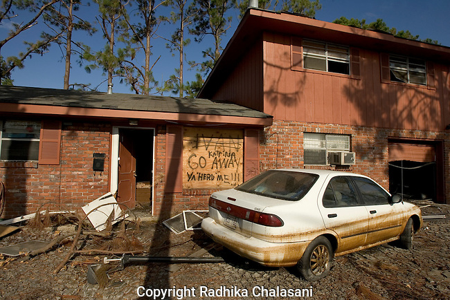 Chalmette, St. Bernard Parish, Louisiana - October 03: A board protecting windows in a home proclaim the owners' feelings about Hurricane Katrina October 02, 2005 in the wake of the disaster caused by the hurricane in St. Bernard Parish.  (Photo by Radhika Chalasani/Getty Images)