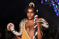 Man with snake<br /> at the Ashish catwalk show as part of London Fashion Week SS17, Brewer Street Car Park, Soho London<br /> <br /> <br /> ©Ash Knotek  D3155  19/09/2016