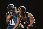 Pictures of rock band AC-DC performing in concert during the 1980's Angus Young Brian Johnson