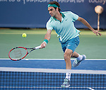 Roger Federer (SUI) battles against Gael Monfils (FRA) at the Western & Southern Open in Mason, OH on August 14, 2014.